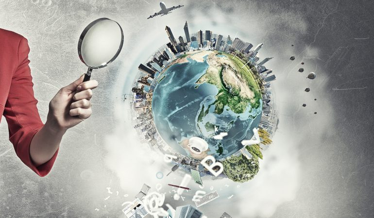 Beautiful woman in red jacket looking through magnifying glass. Elements of this image are furnished by NASA