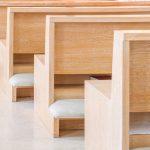 Empty wooden church pews in a modern church or chapel